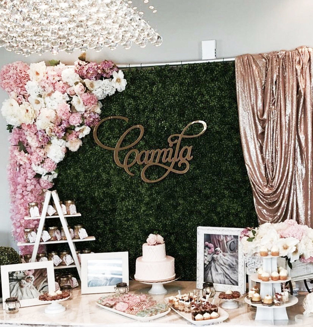 A beautiful gold mirror name sign we made for a luxury first birthday party.