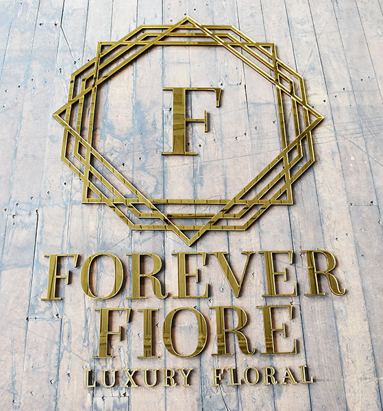 A large mirror business wall sign we made for a luxury florist.