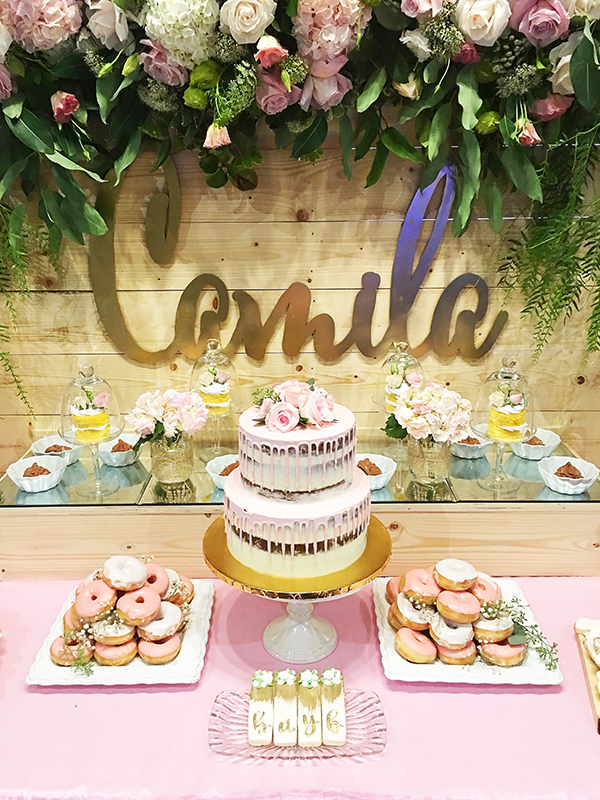 A gorgeous pink and gold dessert display table with our gold painted custom name sign.