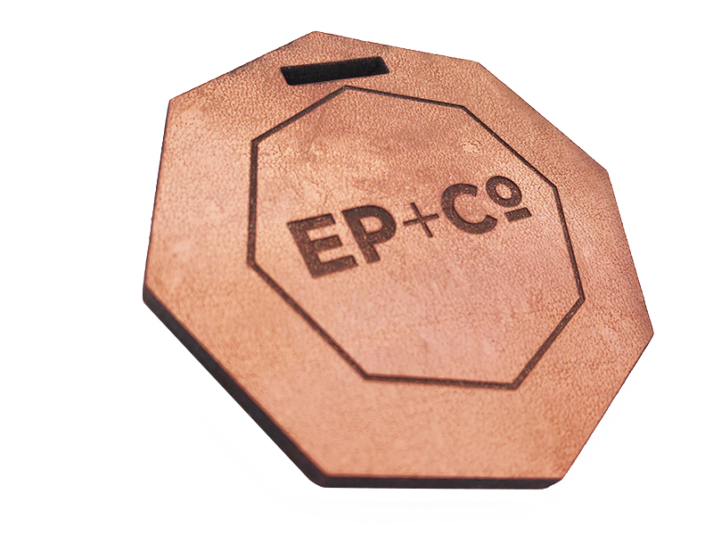 We can engrave and cut leather. This is a leather tag made for Erwin Penland.