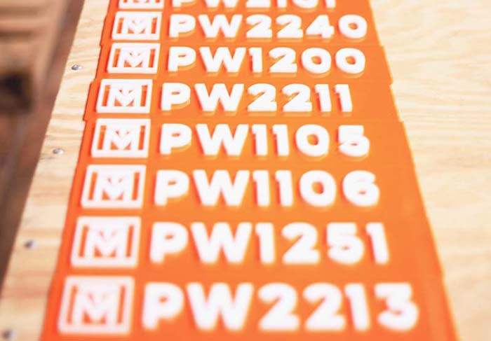 Studio suite numbers we made for each tenant's space at The Taylors Mill, made from white and orange acrylic.