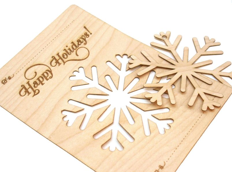 A snowflake pops out of this wood veneer Christmas card, and can be customized with your business logo or special message.