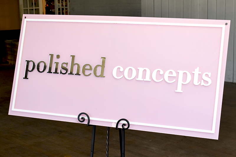 A custom acrylic business sign, about 48 inches long.