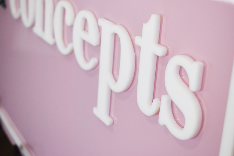 Detail shot of white acrylic on custom pink acrylic for a small business sign based out of Brooklyn.