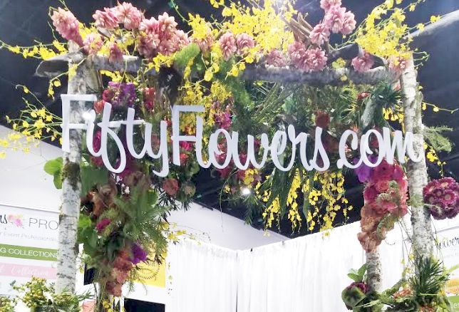 A five foot long white acrylic sign made for the flower company,  Fifty Flowers .
