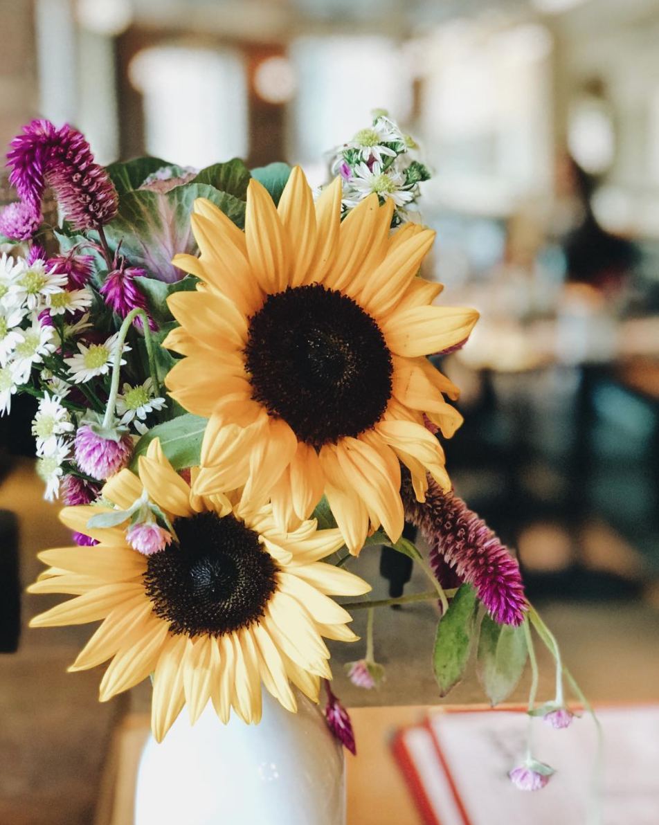 Sunflowers on a table with blurred background