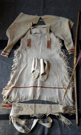 Fringed dress with moccasins and bow and arrow