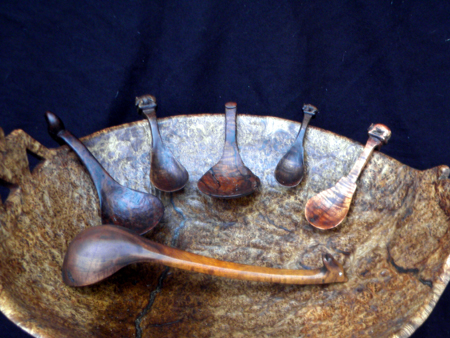 Carved bowl with spoons