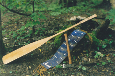 Handmade maple paddle canoe with carved handle, 6 inch wide by 34 inch wampum belt, and trade hatchet