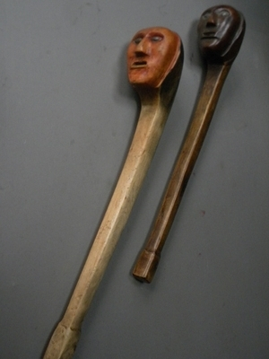 Overhead view of carved wooden clubs