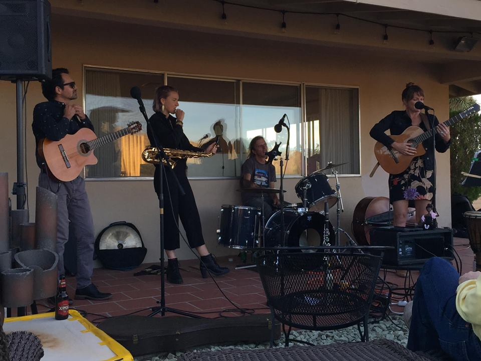 Our performance at the unveiling party for the painting (I sat in on bass for half the songs).