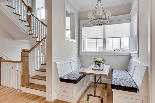These built-in benches, hardwood floors, and staircase bannisters aren't going anywhere!    From our Modern Glam Farmhouse project in Arlington, VA   .