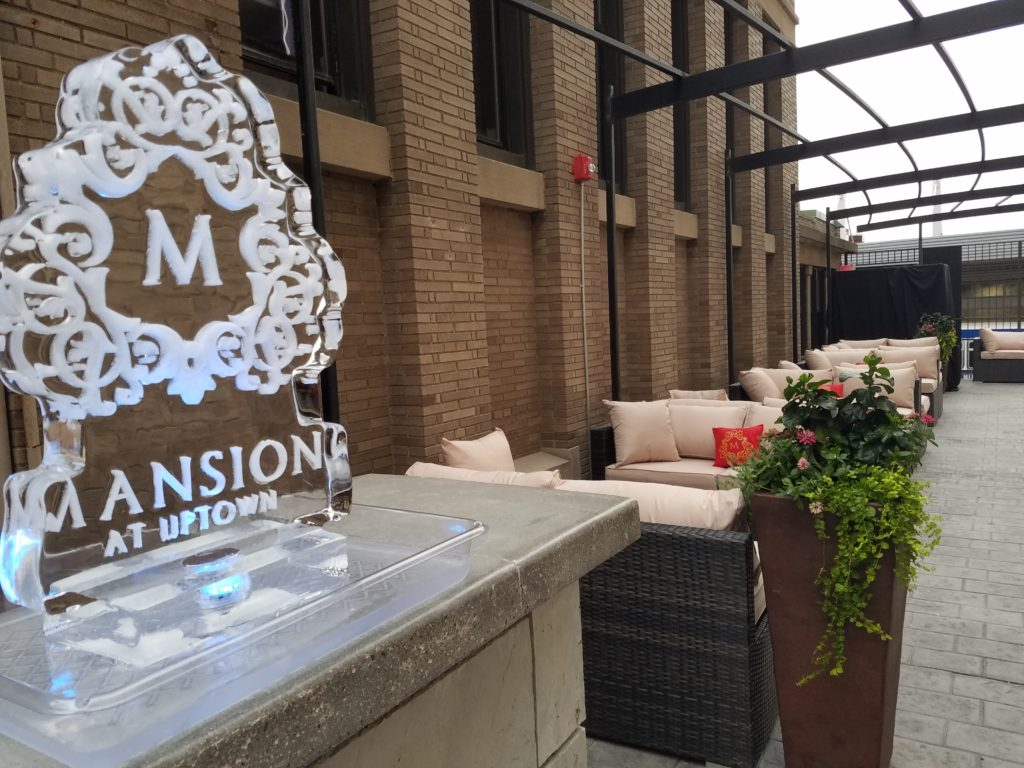 Picture of outdoor patio and ice sculpture at Mansion at Uptown