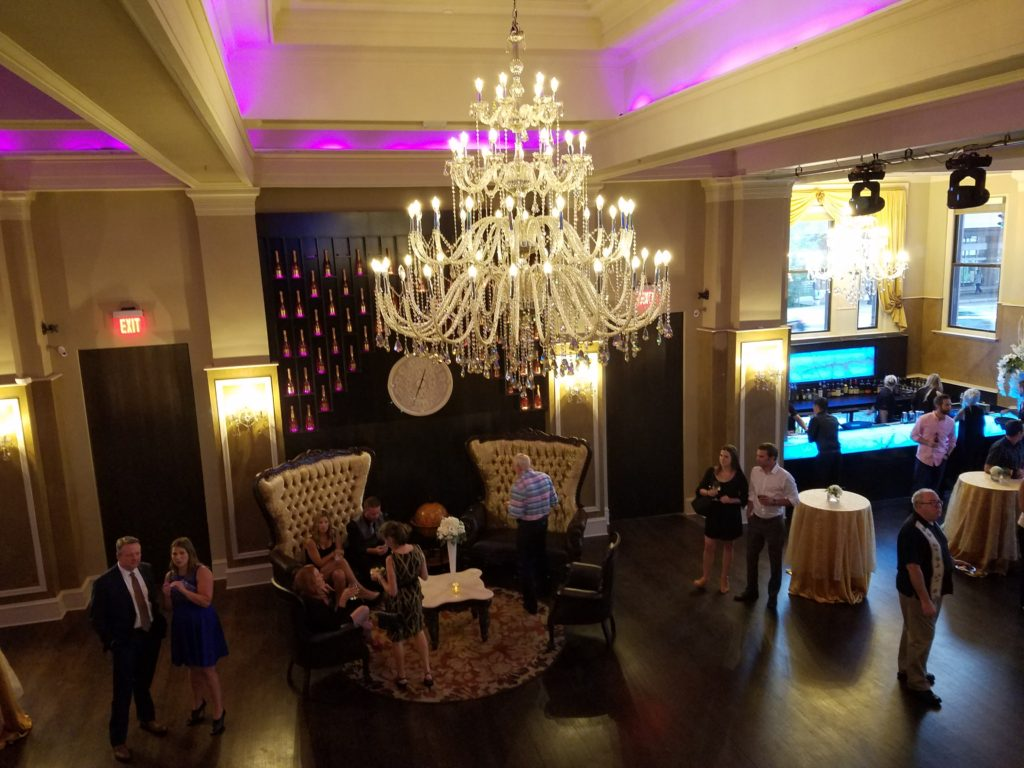 Interior Photo of Mansion at Uptown - Chandelier and Bar