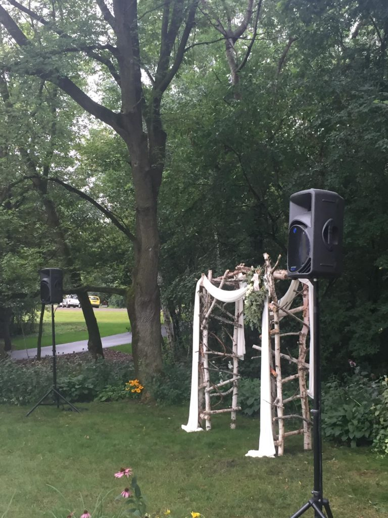 Picture of outdoor wedding archway and AV for You speakers