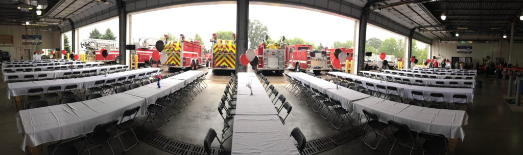 Picture of AV for You Equipment set up for the  Pine Bend Fire Department 25 Year Celebration, includes speakers and fire trucks