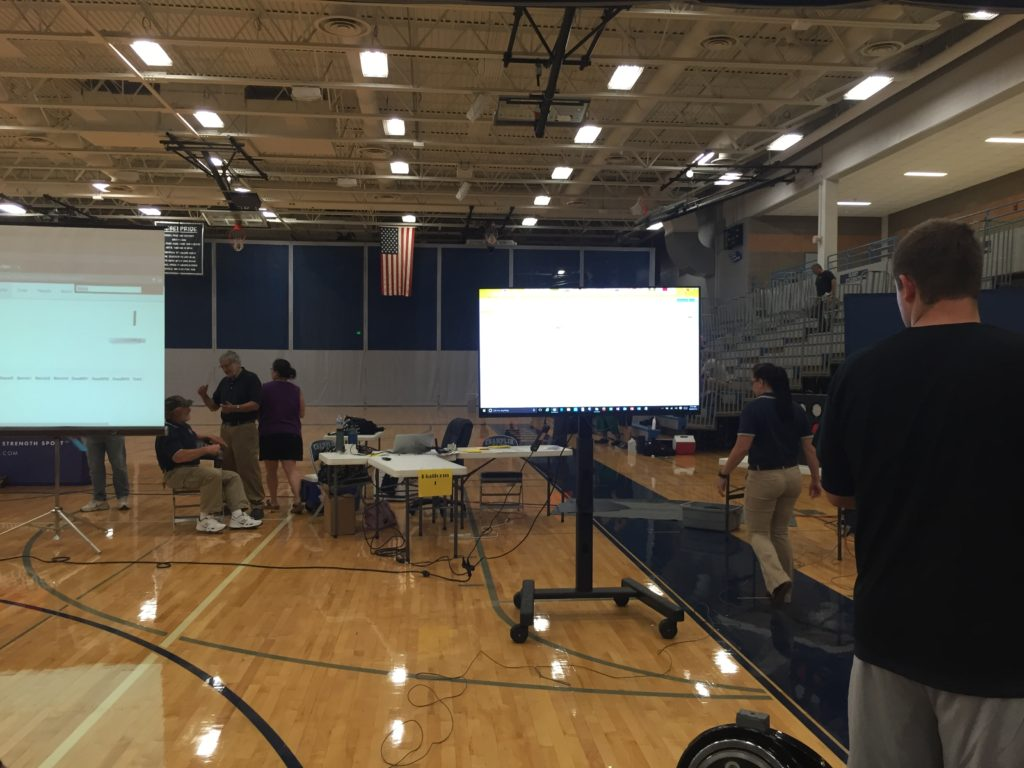 Picture of Champlin High School Gymnasium with a 60 inch TV with stand.