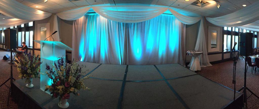 Picture of AV for You audio, lighting, and staging set-up for the North Hennepin Community College's Annual President's Circle Dinner