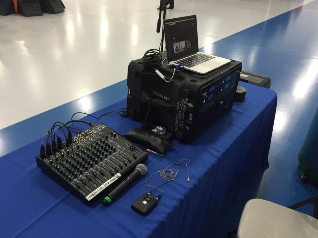 AV for You set up audio, video and truss Structures for a YPO event at the Sun Country Building in Richfield, MN. The picture shows AV for You's tech table, which has our Mackie 1402, and Shure QLXD4 Distro Wireless Mic Rack