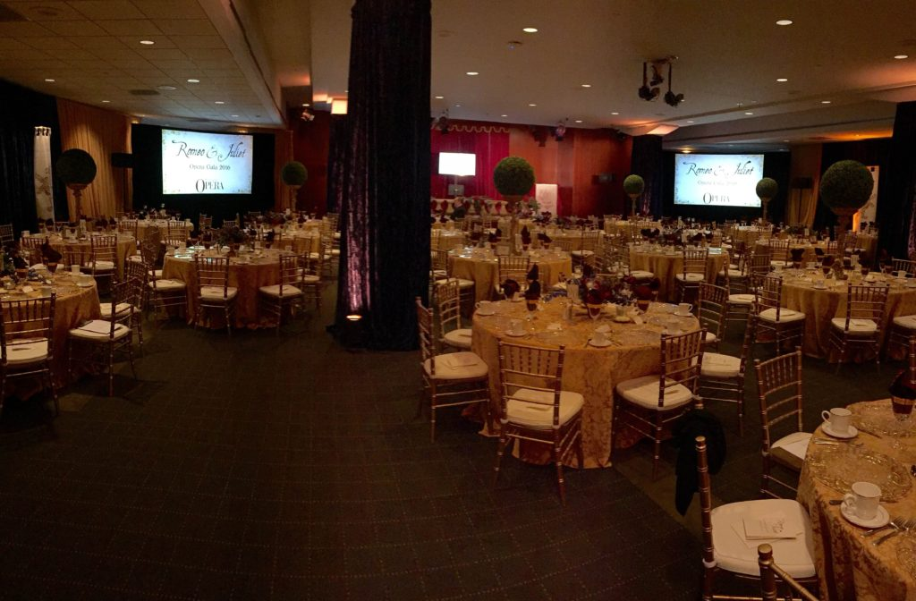 Picture of AV for You audio, video, and lighting set-up for a fundraising event held by the Minnesota Opera at the Travelers Insurance Building in St. Paul.