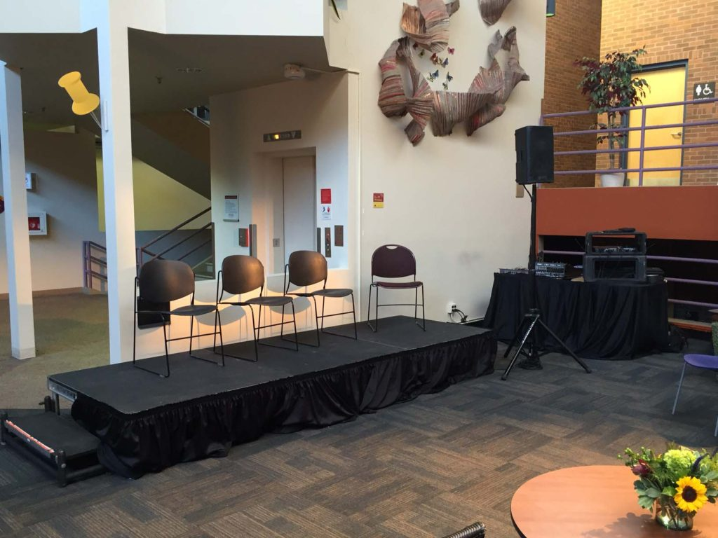 Picture of AV for You audiovisual set-up and staging platform for an event at the University of Minnesota's Learning and Environmental Sciences Building