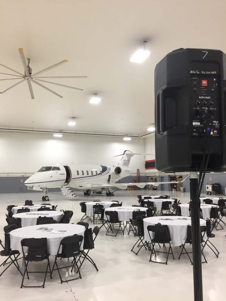 Picture of AV for You audio and visual set-up for the Minnesota Business Aviation Association's October Luncheon at the Best Jets International aircraft hangar in Minneapolis