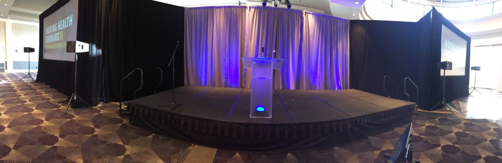Picture of AV for You Rental Blue Cross Blue Shield Minnesota Luncheon at Intercontinental Hotel set-up featuring staging and a frosted podium with uplights