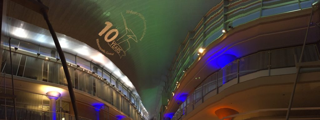 AV for You was thrilled to provide audio, video, and lighting to celebrate the 10th Anniversary Celebration of the Minneapolis Central Library in Downtown Minneapolis, MN. This picture shows the Minneapolis Central Library Logo using our a source 4 light to project a custom made gobo on the ceiling.
