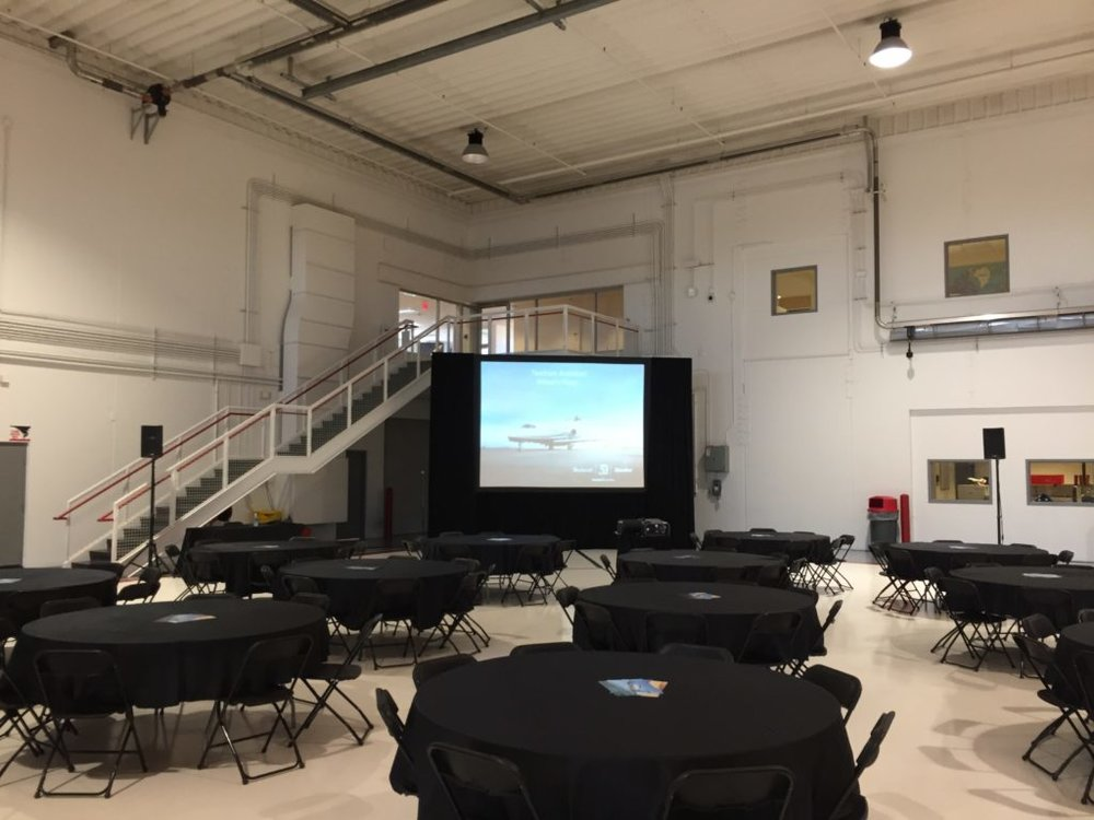 Picture of the AV for You audio/visual set up for a hangar event at MSP airport