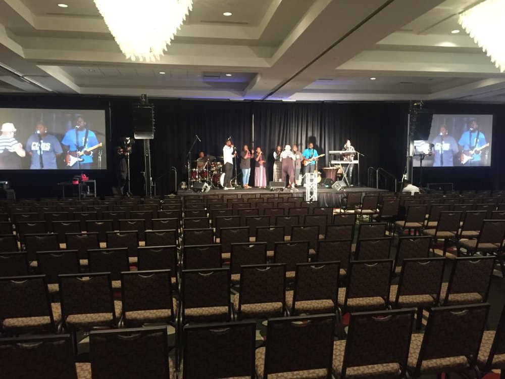 Picture of AV for You audio visual set up for a prayer service at Hilton Minneapolis/St. Paul Airport Hotel