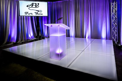 Picture of frosted acrylic podium with uplighting available to rent at AV for You