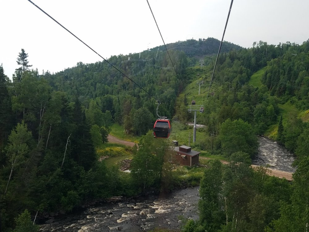 Picture of gondola ride up to the Summit Chalet in Lutsen for a Wedding Reception
