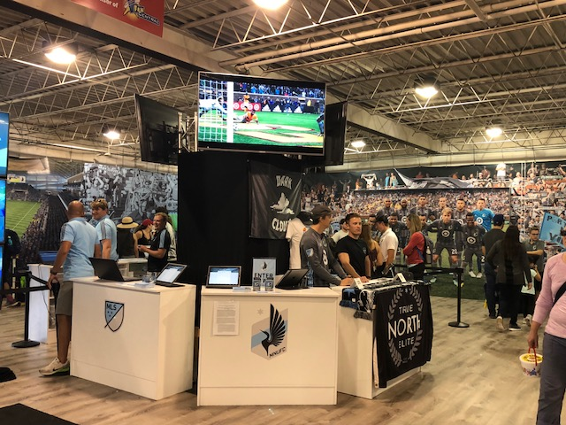 Picture of AV for You monitor set up on truss at the MNUFC booth at MN State Fair