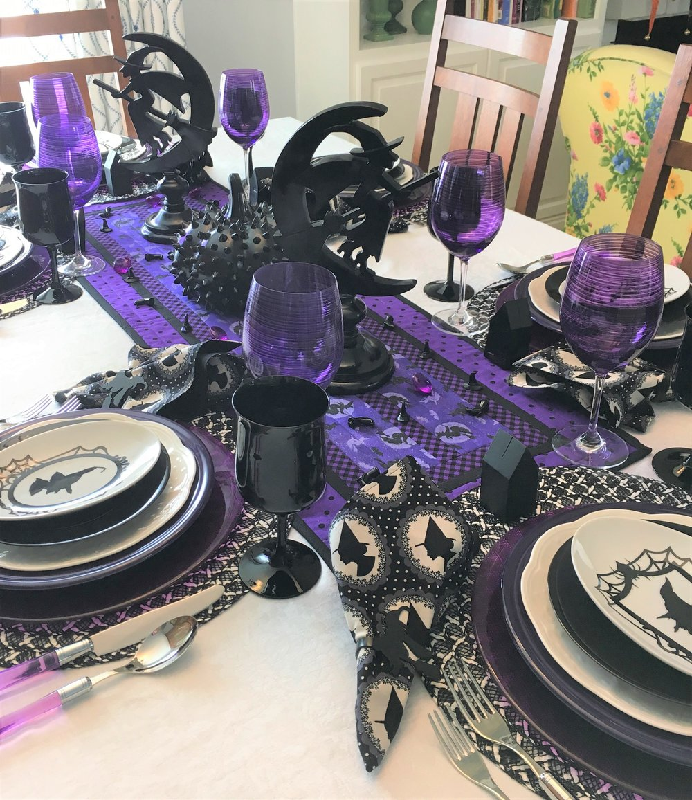 For a change I did a purple, black, and white table this year for Halloween. I picked the theme black witches last year and started gathering what I needed. The table runner was made by someone on Etsy and the colors worked perfectly for what I wanted to do. I also got the napkins on Etsy as well as the witch napkin rings. I saw a witch design I liked and asked if they could make napkin rings, I really love the way they turned out.