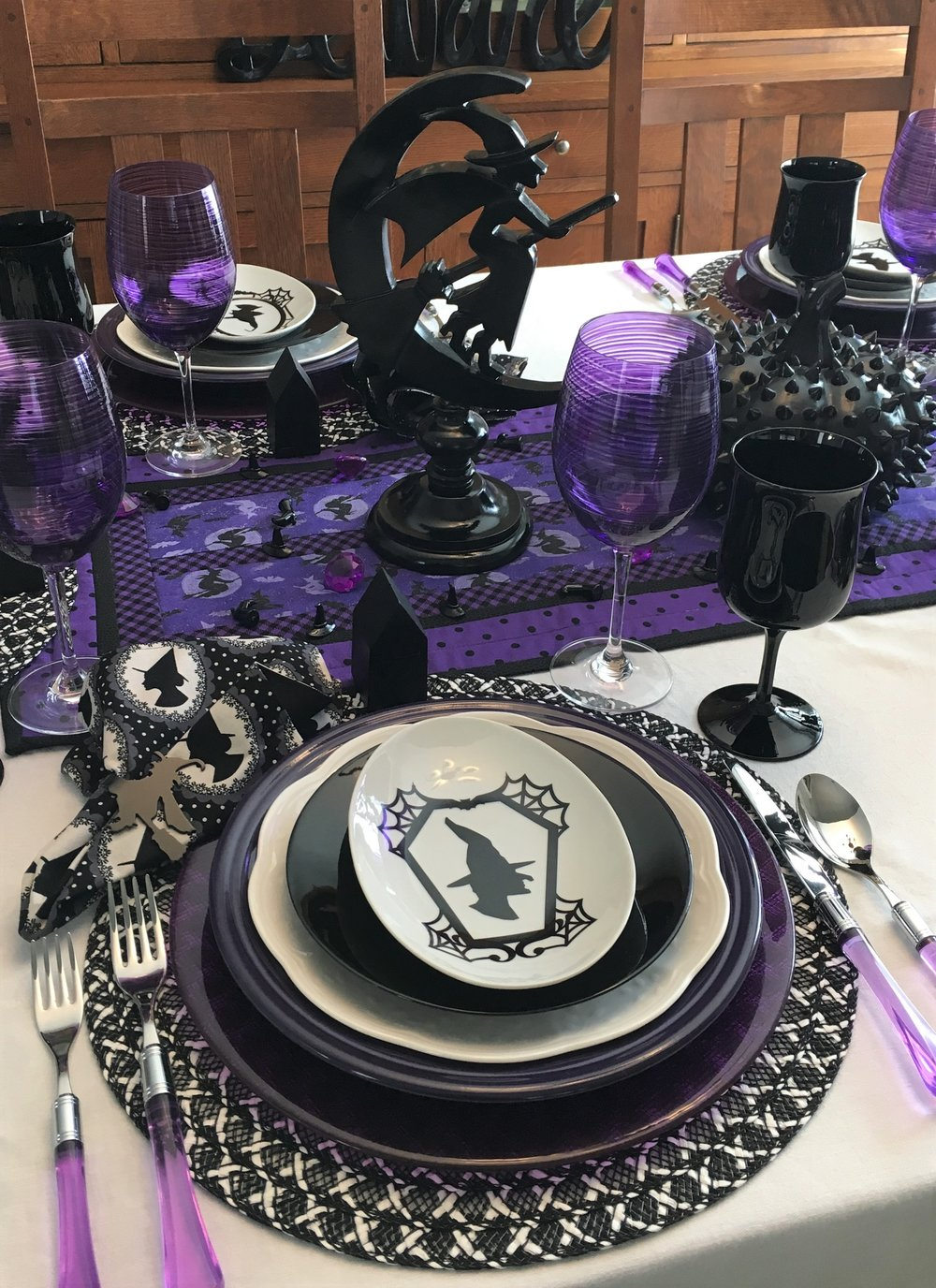 The witch centerpieces came from Pier1. They were a distressed black and I am not a fan of distressed wood so my hubby spray painted them for me, love the way they turned out. The black studded pumpkin is from Pier1 as well as the place mats. Pier1 has good sales from time to time. The chargers are Bormioli Rocco Inca in purple and I bought them on sale on Amazon. Have a few other colors of this one, it is really heavy glass. The picture looks dark but it is a really pretty purple color. Found the purple goblets at HomeGoods. I was able to get 6 at one store and 6 at another one. The black goblets came from Ebay, they are Premiere by the Libbey Glass Company.