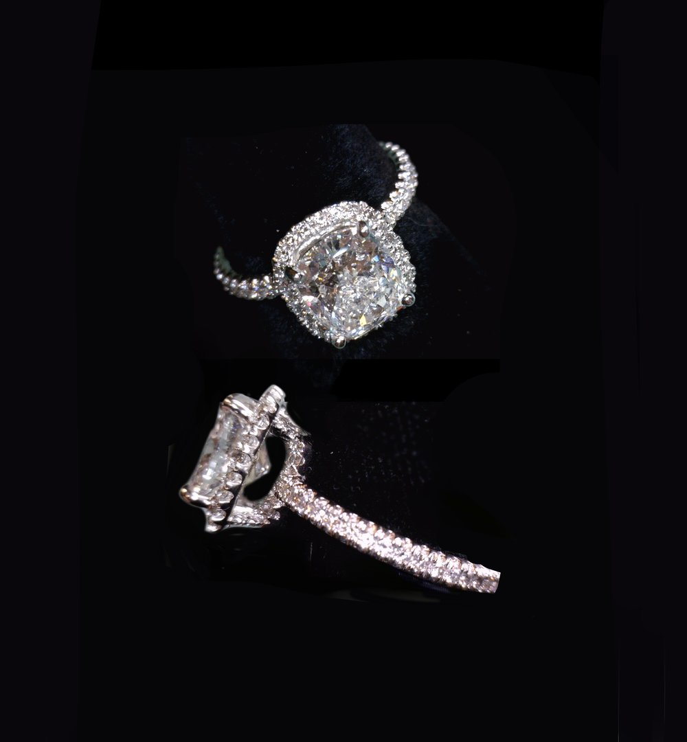 - Cushion cut center 3.02 cts. Halo and diamonds around entire shank.