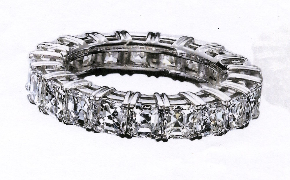 18 asscher cut diamonds weighing 4.56 carats. set in PLATINUM. created a show stopping wedding ring