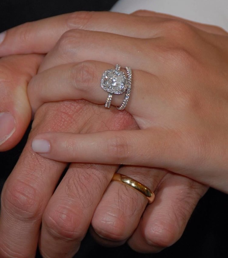 i created this 3.02 carat cusion cut engament ring surrounded by  and made a simple gold band for the husband.