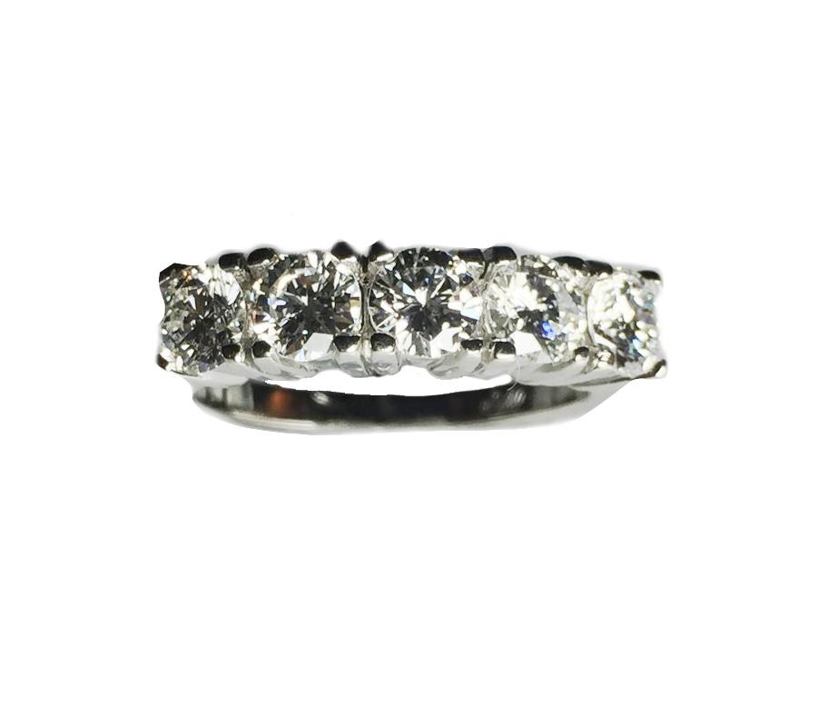 5 QUATER KARAT BRILLIANT CUT DIAMONDS CREATE THIS  ELEGANT WEDDING BAND.