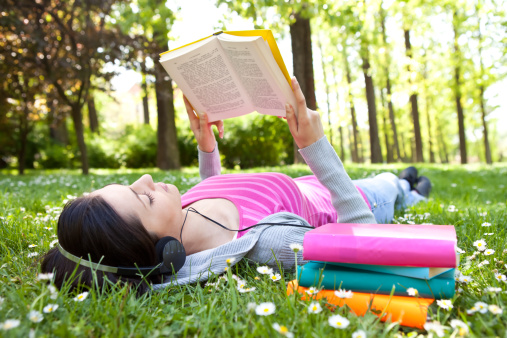 Reading outside with headphones