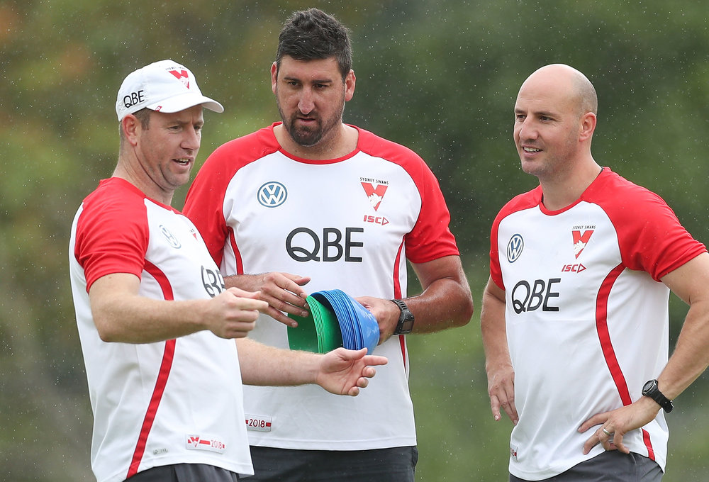Migratory Swan Returns: Tadhg Kennelly (right) with fellow Sydney Swans coaches (from Left) Steve Johnson and Dean Cox.