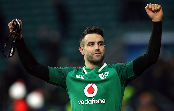 Conor Murray celebrates Ireland's historic Grand Slam at Twickenham.