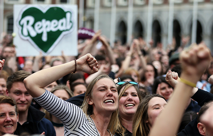 Yes supporters celebrate Ireland's landslide vote for change.