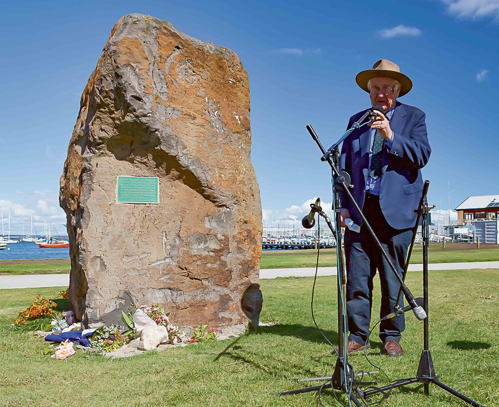 Dr Val Noone next to the Famine Rock at Williamstown.