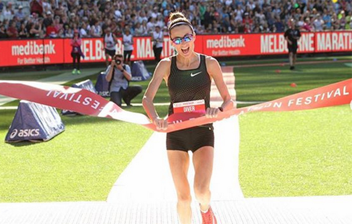 Sinead Diver crosses the finish line at the MCG.
