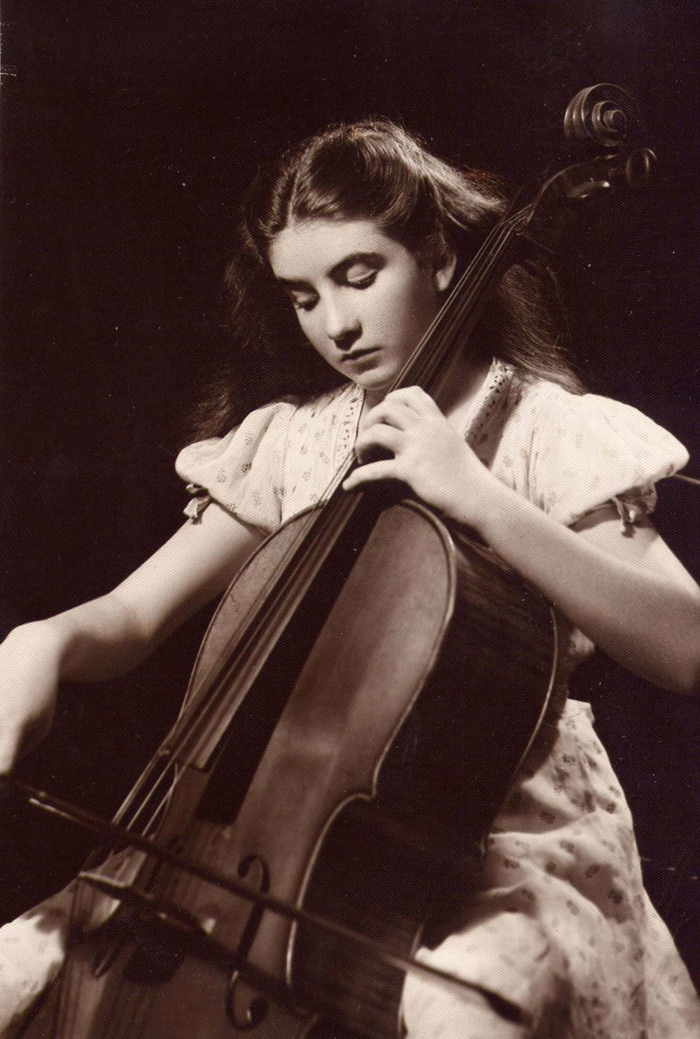 Maureen, aged 12, practicing her cello.