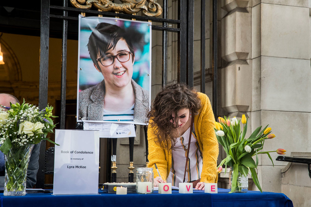 A young woman signs a book of condolence for Lyra McKee in Belfast. Picture: Liam McBurney