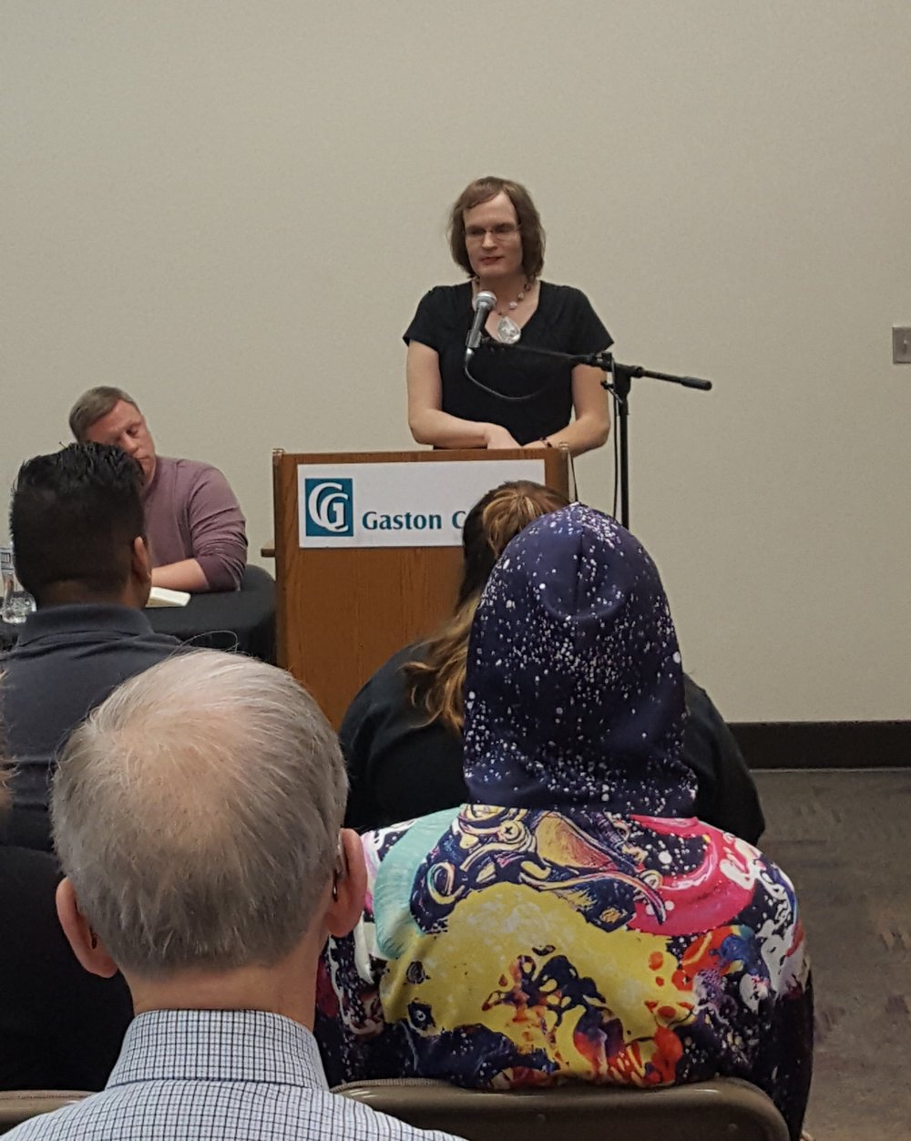 Agape member advocating for Transgender rights during panel discussion at Gaston College