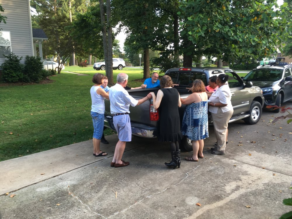 Agape community gathers to bless Dan as he sets out on a mission trip.