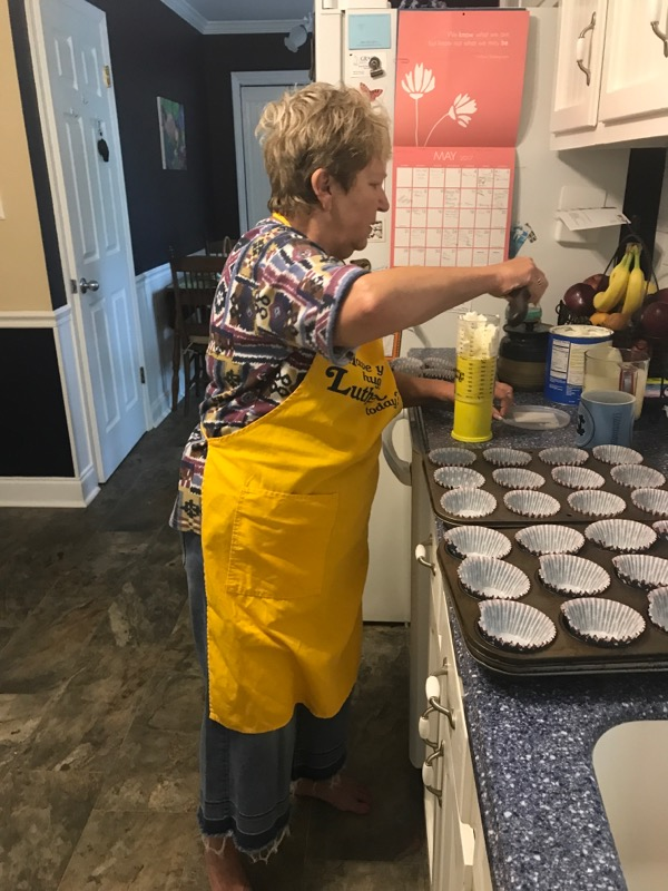 Preparing cupcakes for Heritage Oaks monthly birthday party